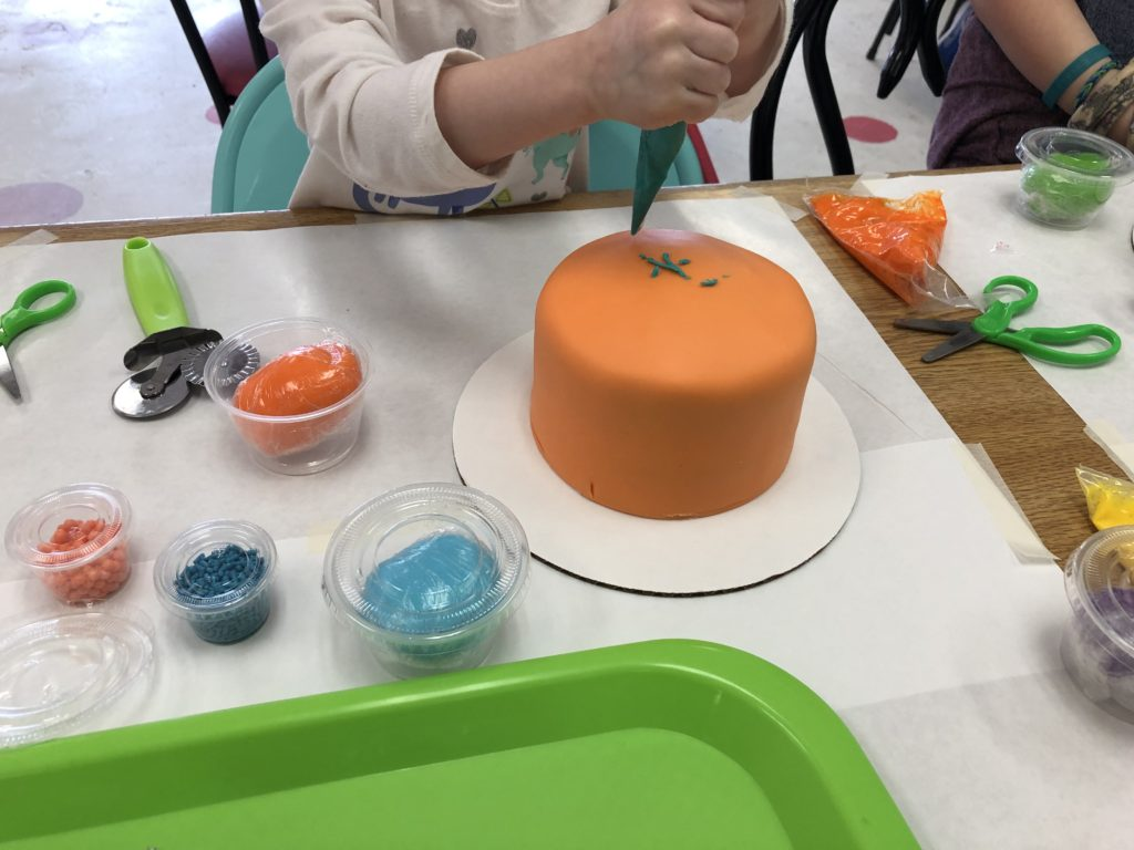 Decorating a cake at Jubilee Cake Studio